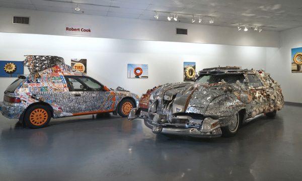 "(left) Joe Hale Haden, ""Wendell"" & (right) David Best, ""Milan Car"": ""Celebration of Art Cars"", 20th Anniversary of the Art Car Museum, installation view, 2018"