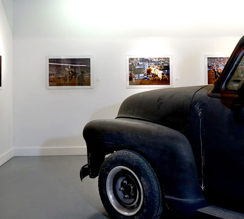 """FOTOFEST 2020, Daniel Kramer: """"GIDDY UP!! A Decade of Documenting the Houston Rodeo,"""" Installation view at the Art Car Museum, Houston, TX, 2020"""